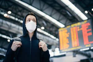 Man wearing protection face mask at airport